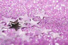Violetter Hintergrund mit Scheinen Stockbild