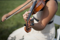 Violin. Closeup of person playing violin focus on headstock Stock Images