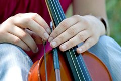 Violin. Holding a violin by a girl Royalty Free Stock Photography