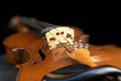 Violin. With the focus on the bridge and f-hole. The rest of the  falls into soft focus royalty free stock photography