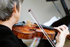 Violin. A women playing the violin Royalty Free Stock Photography