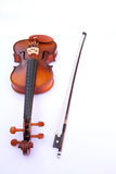 Violin. S and a fiddlestick under the white background Stock Photography
