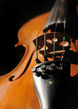 Violin. This beautiful violin has been symphony and music. The shot is close to better show the craftsmanship of this fine instrument Royalty Free Stock Photos