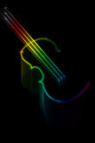 Violin. Multicolored silhouette of a violin on a black background Royalty Free Stock Photography