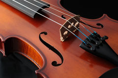 Violin. Detail of a violin on a dark background Royalty Free Stock Photos