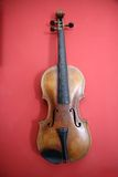 Violin. Old retro used wooden violin stock photography