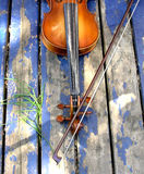 Violin. Over the blue painted porch Royalty Free Stock Image