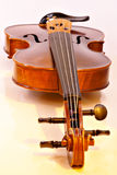 Violin. A violin shot taken from the scroll Stock Images