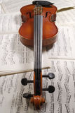 Violin. A violin with background score royalty free stock photography