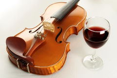 Violin. And glass of red wine Stock Images