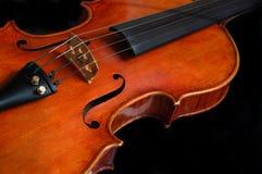 Violin. A violin against black backdrop Royalty Free Stock Image