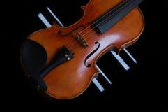Violin. A violin against black backdrop Stock Image