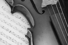 Violin. Detail of violin on music paper - black and white Stock Photo