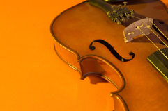 Violin. Old violin over a colorful background stock images