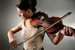 Violin. Young woman playing the violin Royalty Free Stock Photo