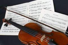Violin. Close up of a violin, bow and music ready for practice stock images