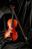 Violin And Bow On Black Silk Stock Images