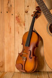 Violin And Guitar On Wood Background Royalty Free Stock Image