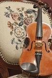 Violin on Antique Chair Royalty Free Stock Image