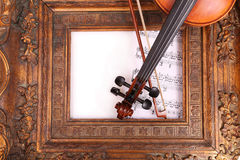 Fiddlestick and violin. Violin and antique vintage picture frame Stock Photo