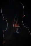Violin artistic silhouette on black. Violin. Artistic silhouette of musical instrument on black royalty free stock photography