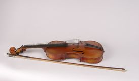 Violin on Back. Antique Violin on Back with Bow Stock Photography