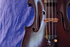 Violin background with bright blue Royalty Free Stock Photo
