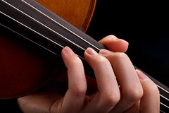 Violin background and fingers Royalty Free Stock Photo