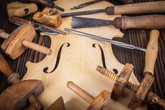 Violin belly and work tools Stock Images
