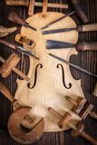 Violin belly and work tools Royalty Free Stock Photos
