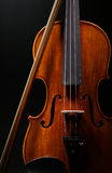 Violin with black background Stock Photos
