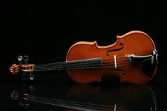 Violin on a black background. Closeup violin on a black background Royalty Free Stock Photo