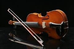 Violin on a black background. Closeup violin on a black background Stock Images