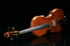 Violin on a black background. Closeup violin on a black background Royalty Free Stock Images
