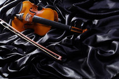 Violin on a black satin Stock Image