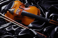 Violin on a black satin Stock Photography