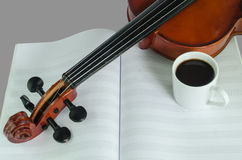 Violin, blank notesheet and a cup of coffee. Closeup photo of violin and roses on note sheet with text space Stock Images