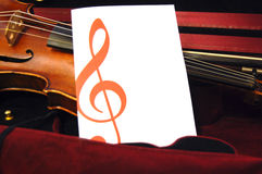 Violin and Blank Page. A violin with a blank page in front of it stock image