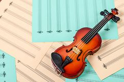 Violin on blank sheets note. Royalty Free Stock Image
