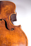 Violin body length. Closeup of top (f-hole) of a beautiful 19th century violin (Pietro Floriani). Shot under studio lighting against white background Stock Images