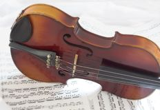 Violin Body with sheet music. Violin on side with sheet music royalty free stock photos
