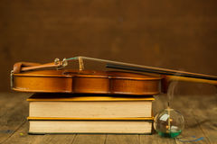 Violin and book Stock Images