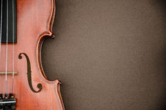 Violin. Border on brown background royalty free stock photography
