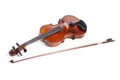 Violin + bow. Violin and bow on a white background Stock Images