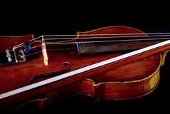 Violin and bow. Isolated on black background Stock Images