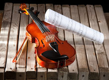Violin and bow. On wood background Stock Images