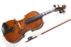 Violin & Bow. A violin and bow isolated on a white background Stock Photos