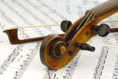 Violin and bow. On musical score Stock Images