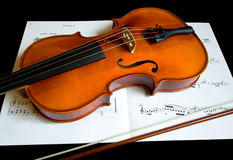 Violin and a Bow. This is a close-up of a violin and a bow on a music sheet Royalty Free Stock Photo