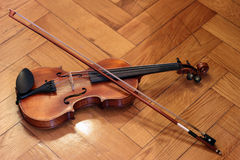 Violin and bow. On wooden floor Stock Images